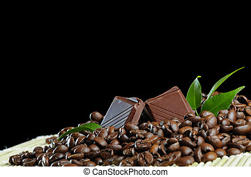 Chocolate - chocolate block in coffee grains