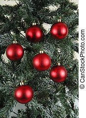 red ball ornament on pine tree
