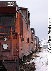 Caboose and rail cars - An old caboose and rail cars sit...