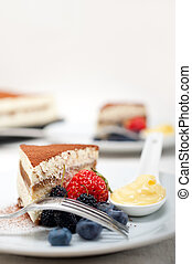 tiramisu dessert with berries and cream - classic Italian...