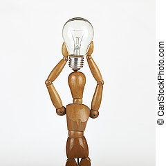 wooden dummy thinking with idea bulb above his head over...