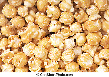 Toffee popcorn - A background of fresh toffee coated popcorn