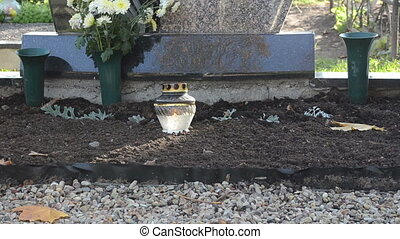 candle glass grave burn - candle in glass pot burn near...