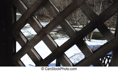 gate river water winter - view through wooden garden gate...