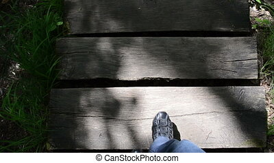 step wooden stair park - man legs with black shoes go down...