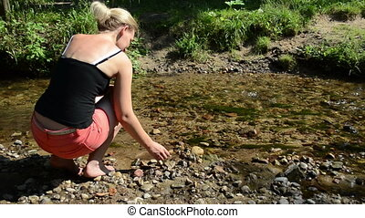 woman stream throw stone