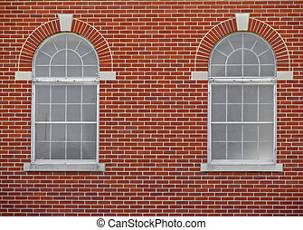 windows - two arched windows on red brick building