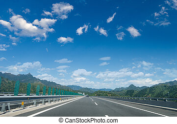 Expressway and the sky - Empty countryside asphalt road and...
