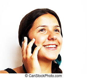 Smiling girl during phone call on white background.