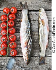 mullet - raw mullet with cherry tomatoes