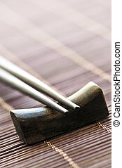 Chopsticks - Set of wooden chopsticks on rest close up