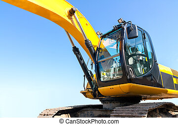 Earth mover - Yellow excavator at construction site