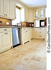 Tile floor in modern kitchen - Ceramic tile floor in a...