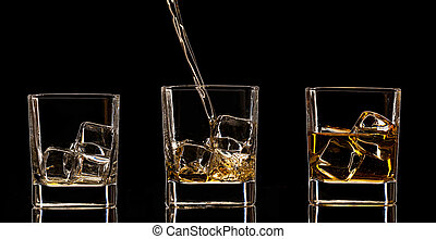 Whiskey drinks on black background