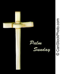 Palm Sunday cross made from leaf over black - Real palm leaf