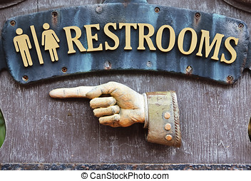 Sign for restrooms - Sign with hand pointing direction to...