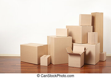 Cardboard boxes, moving day - Cardboard boxes in apartment,...