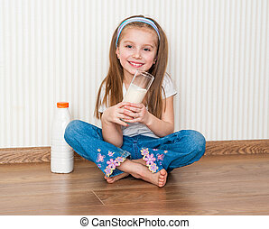 little smiley girl drink the milk in her home - little...