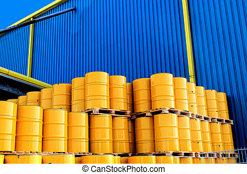 Yellow oil drums and factory - Yellow oil drums in front of...