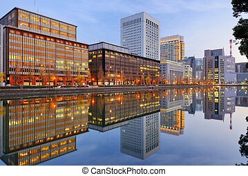 Marunouchi district of Tokyo - Landmark buildings reflect...