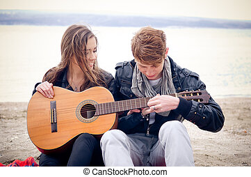 Let me show you - Young girl with acoustic guitar and her...