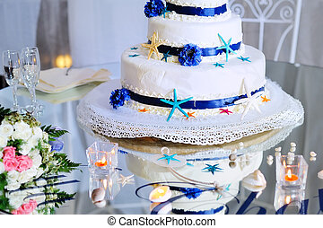 wedding cake with bouquet and stemware - eatiful decorated...