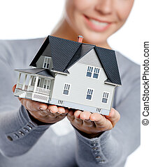 Close up of model house in female hands - Close up of small...