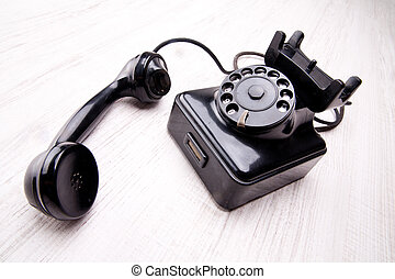 old rotary dial telephone - Black rotary dial telephone on a...