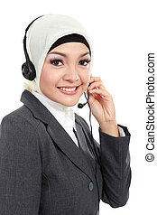 beautiful Muslim woman on the phone - close up portrait of...