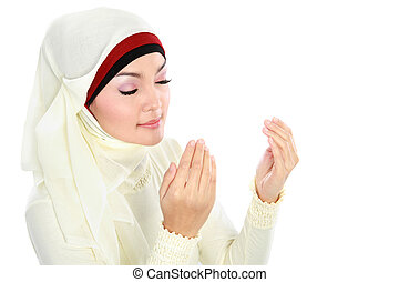 Young Woman Praying - Young beautiful muslim Woman in scarf...