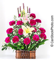 Basket of Carnation and lily isolated on white