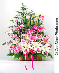 Basket of Carnation lily and rose isolated on white