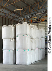 Big bag - stack of big bag contain rice in warehouse