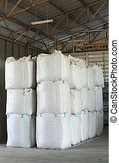Big bag - stack of big bag contain rice in warehouse