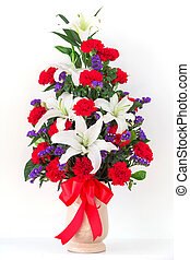 Bouquet of canation and lily in a vase