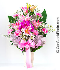 Bouquet of carnation lily and orchid in a vase