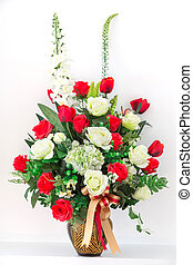 Bouquet of red and white roses in a vase