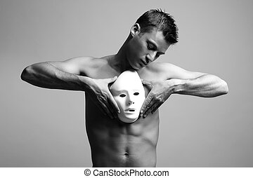 man with mask. black and white fashion art photo.