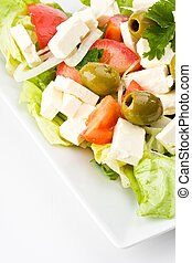 detail of a greek salad on a plate