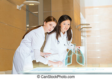 modern medical research - two doctors stand near glowing...