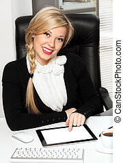 businesswoman in the office with pad