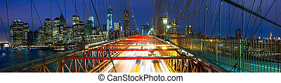 Brooklyn Bridge panorama with traffic - Manhattan skyline...