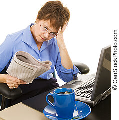 Discouraging Financial News - Worried woman reading the...