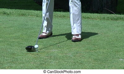 Golfer hitting a tee shot