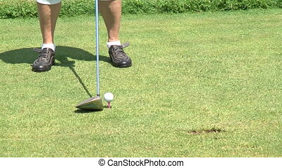 Golfer hitting a tee shot during a match