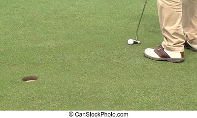 Golfer misses the hole