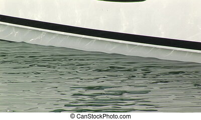 Waterline of a yacht - Waterline and porthole of a docked...