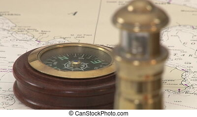 Antique compass and lantern on a map