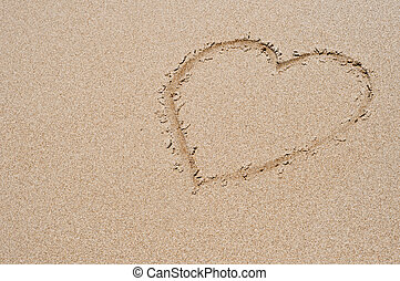 We love summer - Heart drawn on sandy beach
