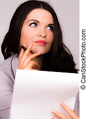Business women writing on pad - A high resolution image of a...